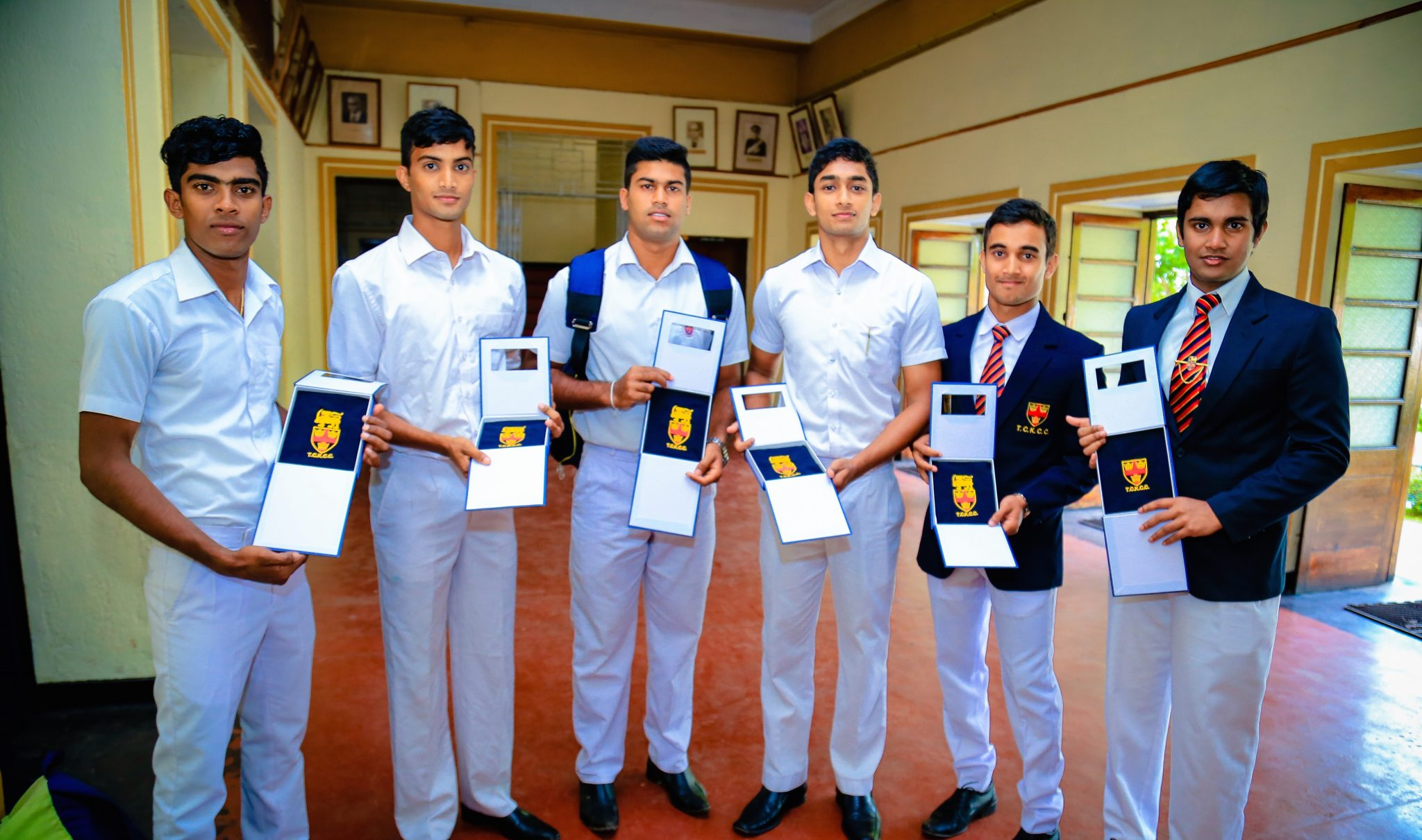 Lionsmen with medals at Trinity College Kandy